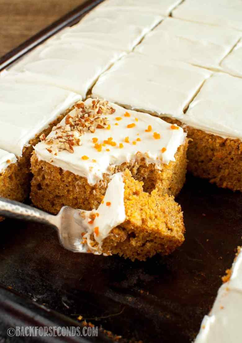 carrot cake with cream cheese frosting on sheet pan
