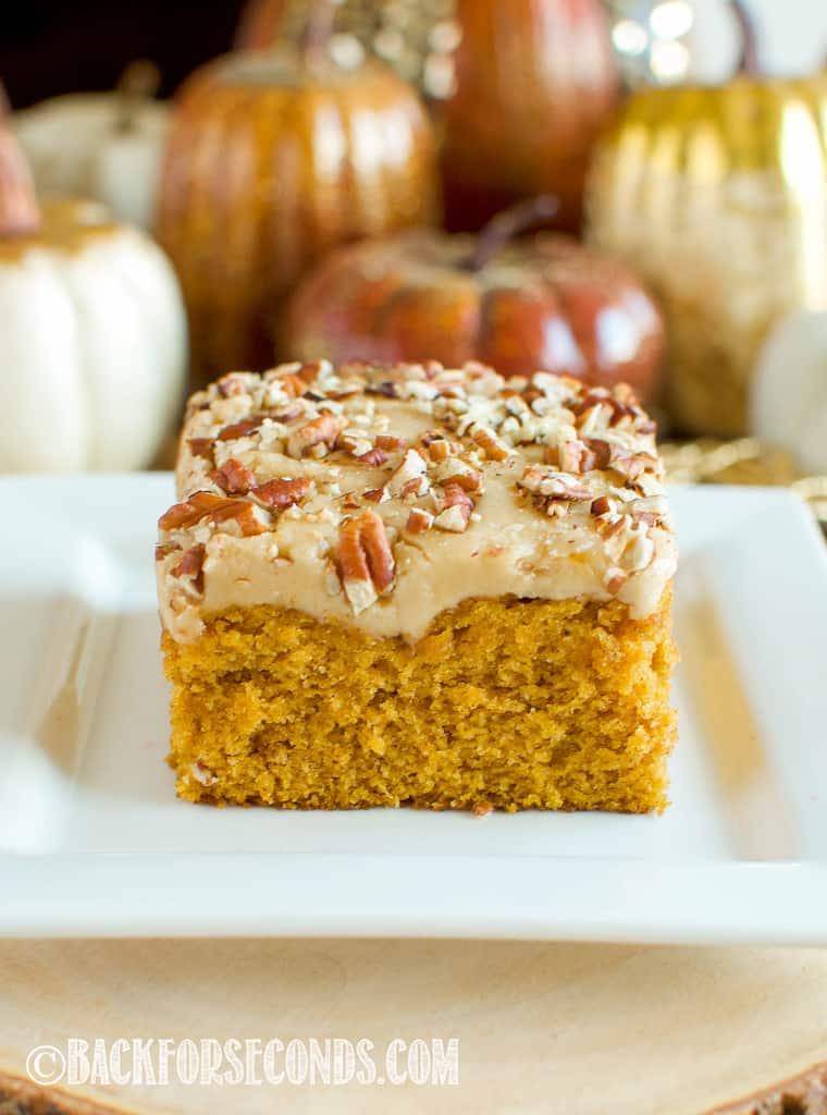 pumpkin praline cake slice on a white plate