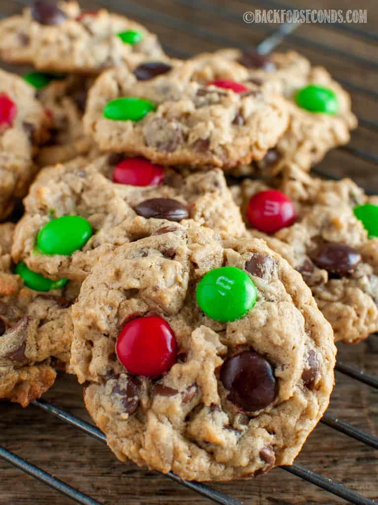 Best Christmas Monster Cookies piled on a cookie rack