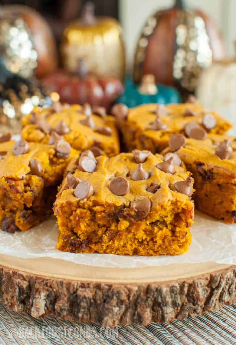 pumpkin chocolate chip bars on a rustic platter
