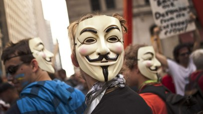 """Image: people wearing """"Anonymous"""" masks"""