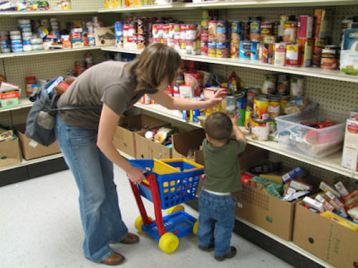 Image: Mother and son at food bank