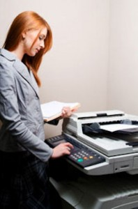 Image: A young woman making photocopies