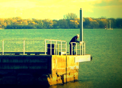Elderly man on a dock