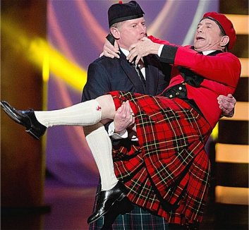 Martin Short is carried as bagpipes