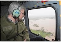 Stephen Harper in helicopter overlooking floods
