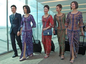 Kebaya-clad Singapore Girls (and boy)