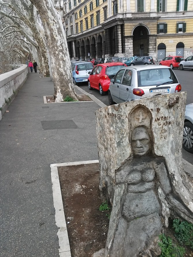 Street art carved into a tree stump