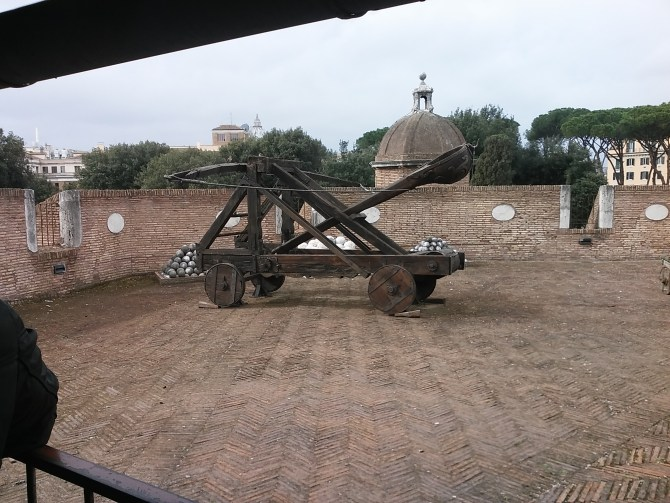 A catapult inside the castle