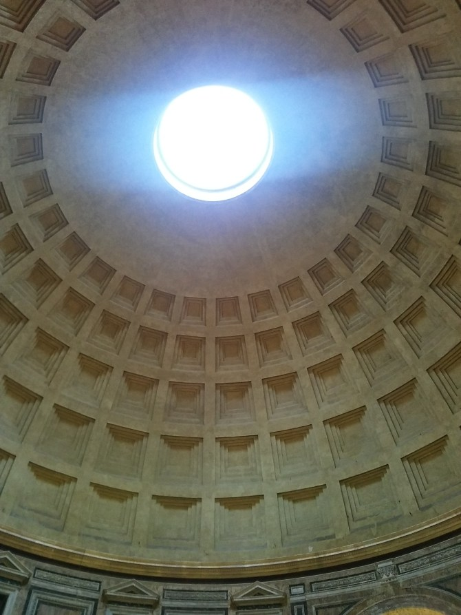 The Pantheon! Which has a giant hole in the top. Brilliant! Everyone was huddled to the walls for a while when the rain was at its strongest.