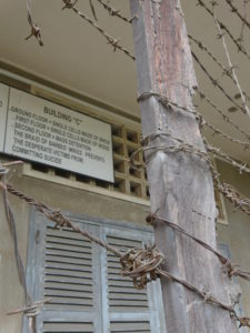 Girls Who Travel | a barbed fence at Tuol Sleng