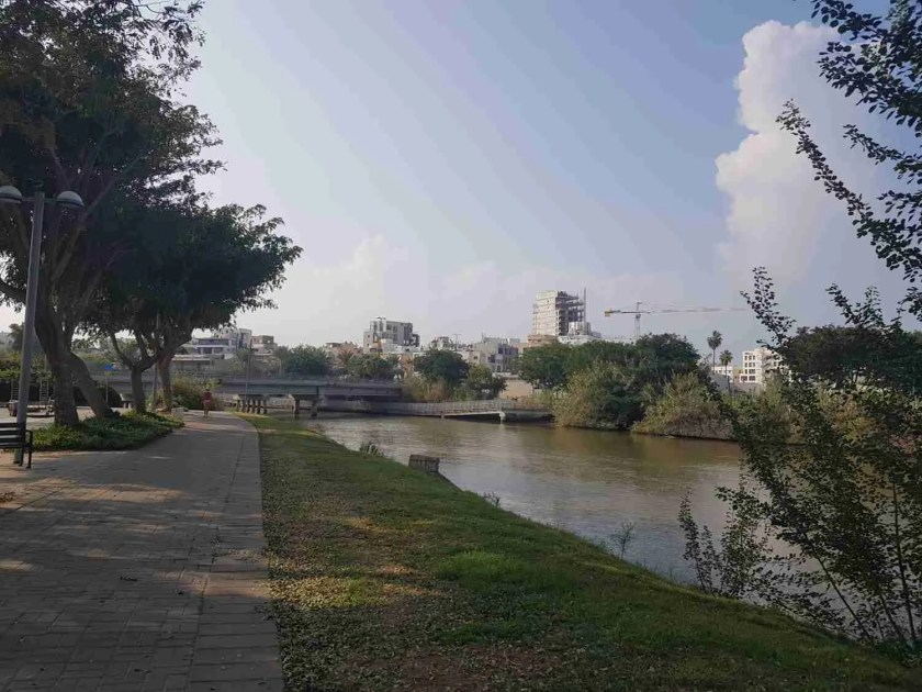 Walking next to the Yarkon River on the Israel National Trail