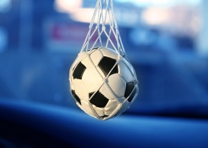 Football hanging from car wing mirror