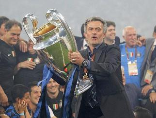 Inter Milan's manager Mourinho holds the trophy following their Champions League final soccer match against Bayern Munich in Madrid