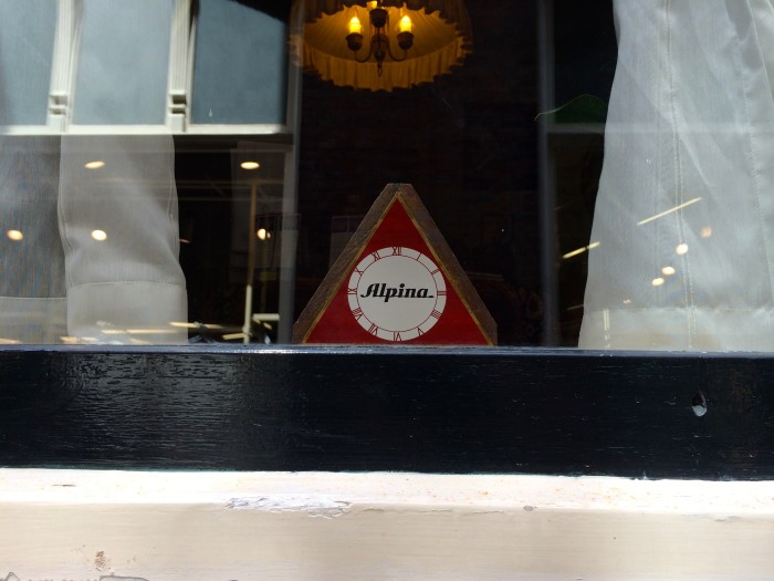 The Alpina triangle in the window of the Corrie ten Boom House Haarlem, Netherlands.