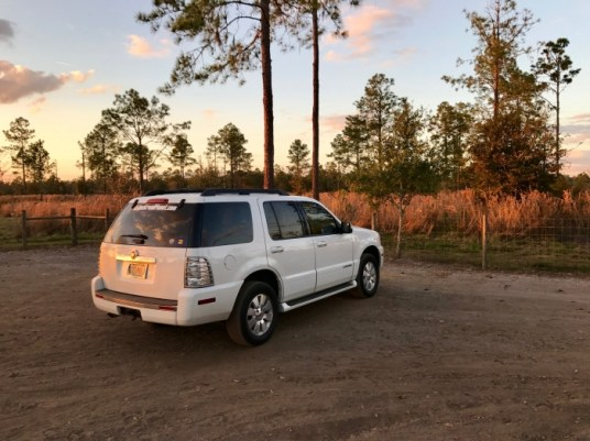 Mercury Mountaineer parked at sunset