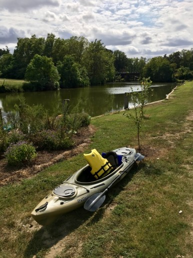 kayak beside a river