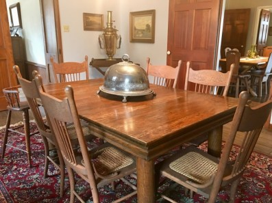 dining table with domed silver platter