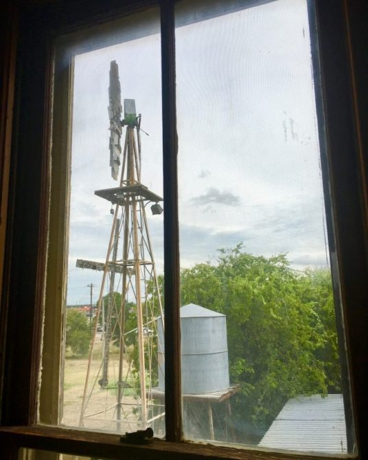 windmill and water tank through a window