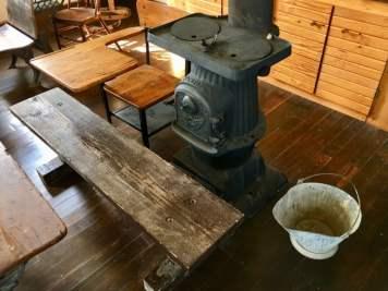 pot belly stove and vintage school desk