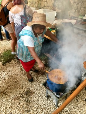 woman stirring pot of authentic Mexican food