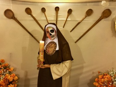 Day of the Dead nun holding candle