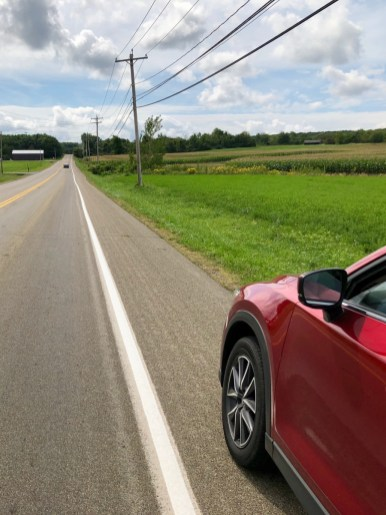 Red Mazda on a roadside pullover.