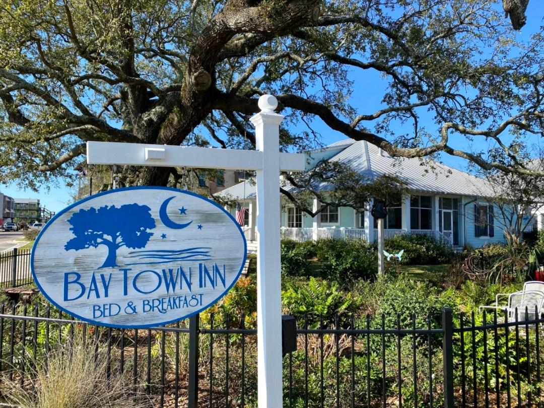 Bay Town Inn sign - 10 Distinctive Places to Stay in Coastal Mississippi