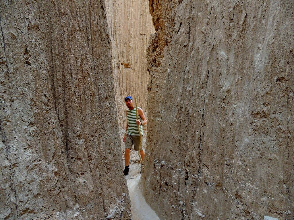 """Eric exploring the """"caves"""" in Cathedral Gorge State Park"""