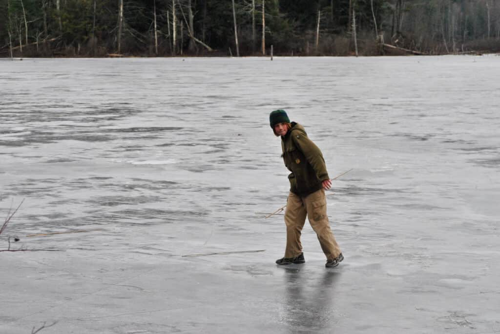 A boy playing on the ice at Woodford State Park.