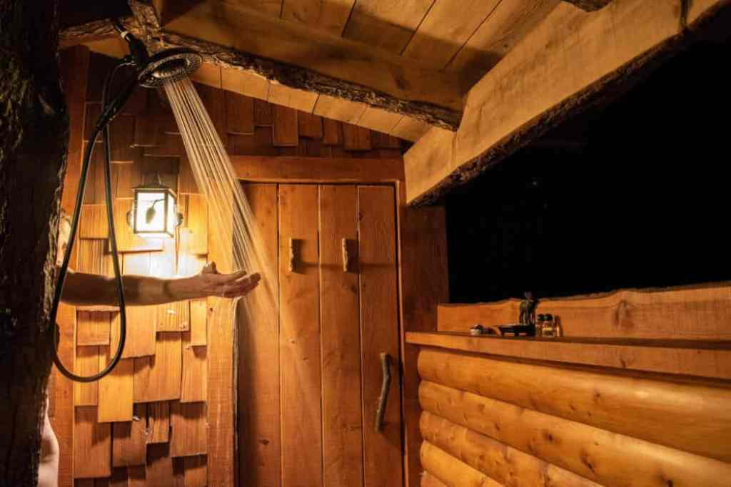 The outdoor shower at Moose Meadow treehouse near Waterbury, VT