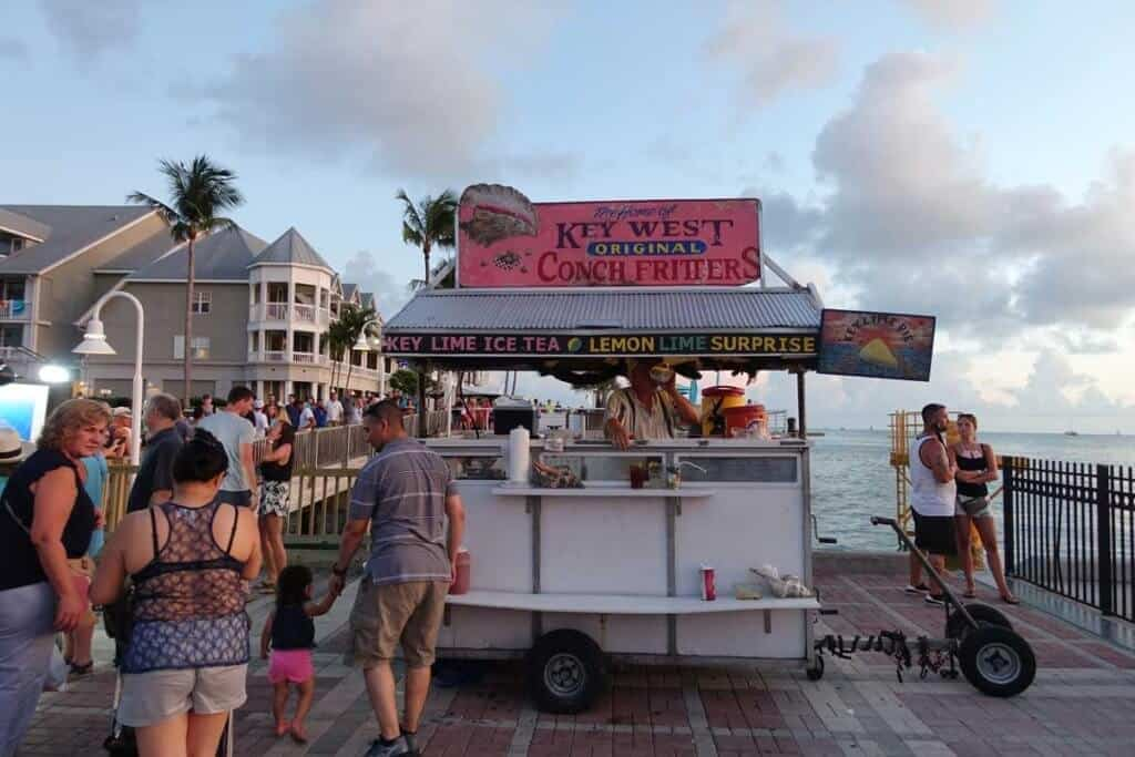 Several people wait at a food stand in Key West, Florida