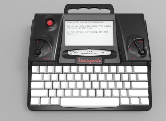 FreeWrite smart typewriter. White keyboard and e-ink screen at the top displaying some text