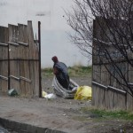 Man collecting garbage in a huge bag