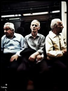 3 men in the metro
