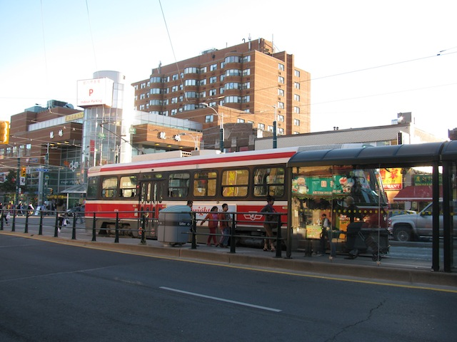 A bus passing through Chinatown in Toronto, Ontario.