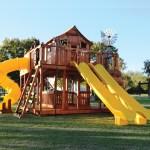 Fort Ticonderoga, twister slide, cabin, rock wall, wooden swing set, swing set, swings, slide, swing set for kids, kids, children, play, playground, playset, sets, accessories, backyard swing set