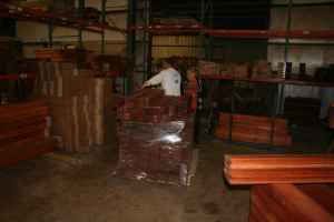 justin factory, workers in the factory, redwood boards, justin store, swing sets, playsets