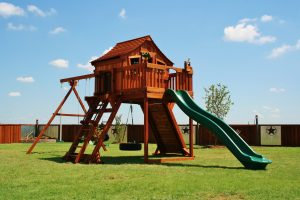 angle leg swing sets, fort ranger, ranger, cabin, tire swing, deck, rock wall, wooden swing set, swing set, swings, slide, swing set for kids, kids, children, play, playground, playset, sets, accessories, backyard swing set