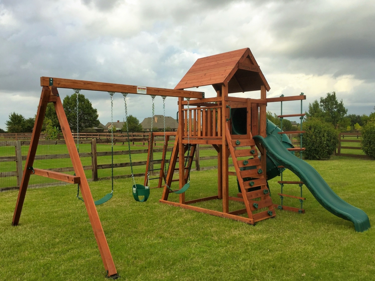 playset, spiral slide, monkey bars, siwngs, tube slide, rock wall, belt swing, child, outdoor playset, trapeze bar