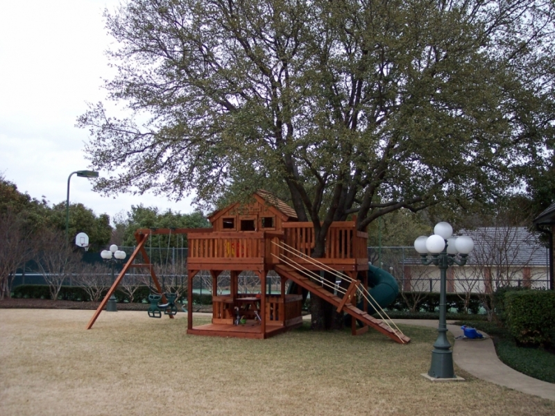 belt swing, cabin, fort, fort stockton, fun deck, glider, name plate, picnic table, slide, snack time, swing beam, swing set, tree climbing, tree platform, twister slide, outdoor playset