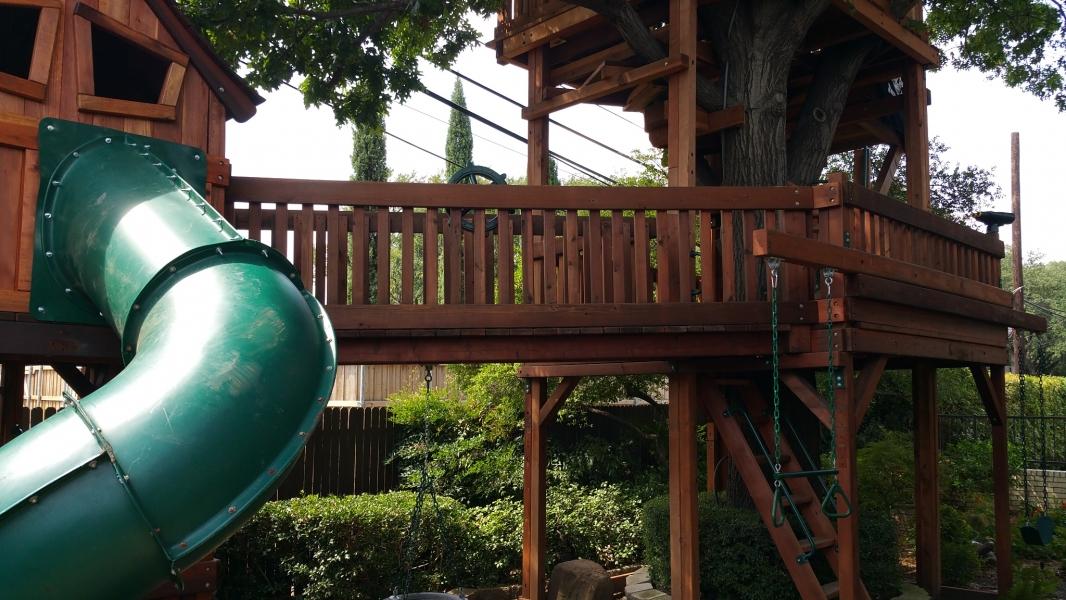 accessories, backyard, binoculars, bridge, family, fort, fun, monkey bar, pirate flag, ships wheel, tire swing, trapeze bar, tree house, twister slide