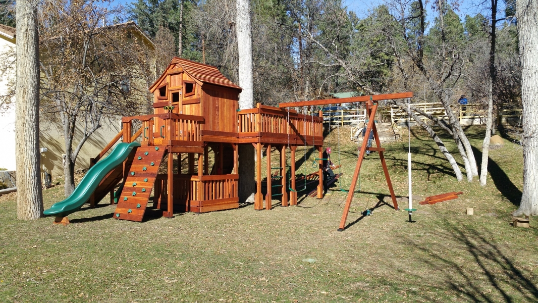 air pogo, belt swings, binoculars, cabin, fort stockton, fun deck, monkey bars, playset, rock walls, ships wheel, slides, trapeze bar, tree deck, wooden playset