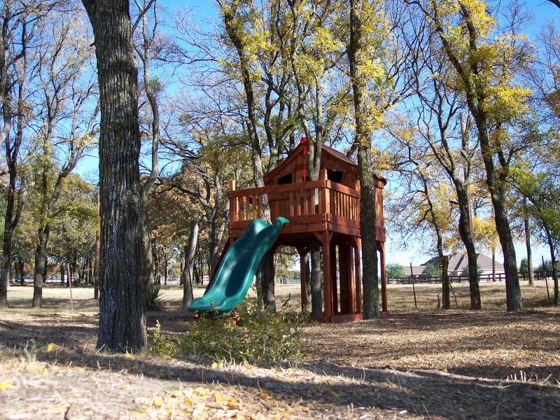 cabin, fort stockton, fun deck, rock wall, slide, tree platform, outdoor playset