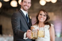 Jen & Bill's amazing 4th of July wedding reception in the Barrel Room at Prairie St. Brewhouse in downtown Rockford, IL, with Felix & Fingers and 4th of July fireworks on the dock – Wedding photographer - Ryan Davis Photography – Rockford, Illinois.
