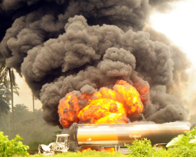 "Tankers loaded with fuel are on fire after a collision with another tanker in Port Harcourt, Rivers State July 20, 2012. Five petrol tankers were involved in an accident at Eneka district in Rivers state, and residents again ""rushed to the scene to scoop fuel, but were forcefully stopped"" by the military,  said Yushau Shuaib, spokesman for the National Emergency Management Agency. AFP PHOTO/STR"