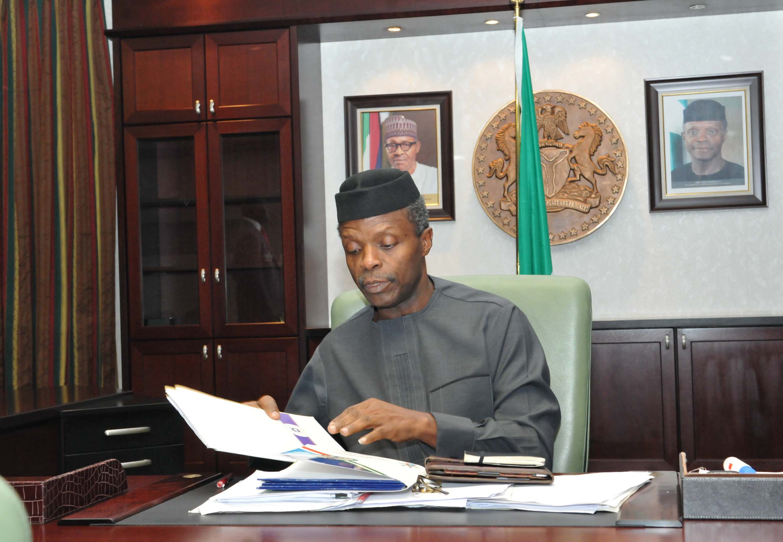 PIC 27. VICE PRESIDENT YEMI OSINBAJO GOING THROUGH  FILES AS HE ASSUMES OFFICE  AT THE PRESIDENTIAL VILLA IN ABUJA ON MONDAY(22/6/15). 4057/22/6/2015/ISE/CH/NAN