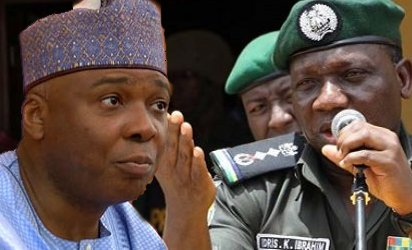 Saraki shakes hands with IGP Idris at Armed Forces Remembrance Day celebration