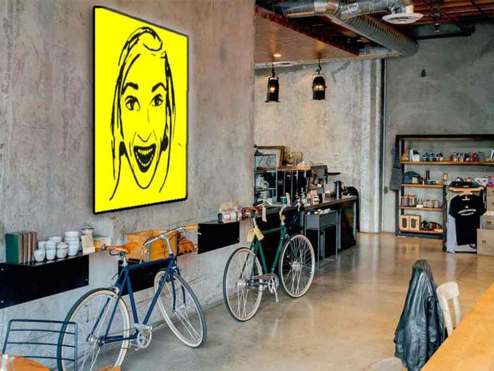 Visage Happy imprimé sur papier en noir sur fond sur jaune. Différents formats possibles.