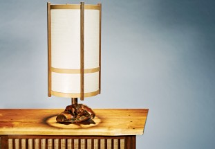The lamp Nakashima designed in 1978 for Edmund Bennett of Bethesda, Md., incorporates a natural root base and an architecturally inspired shade